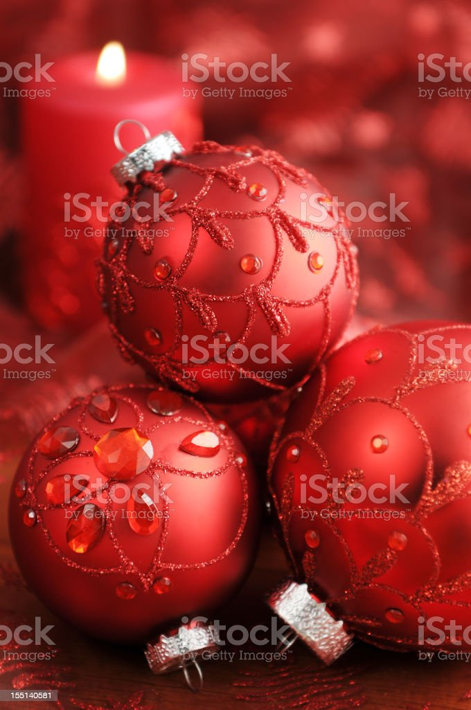 Christmas Ornaments and candle with on red tablecloth stock photo