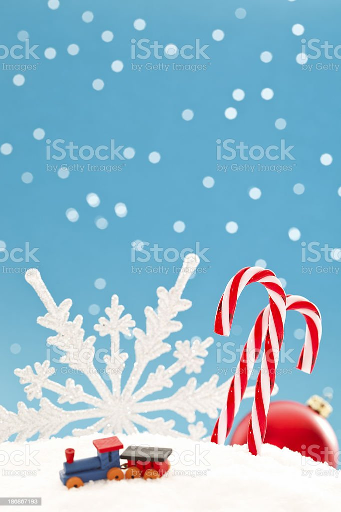 Christmas ornaments and tiny wooden toy royalty-free stock photo