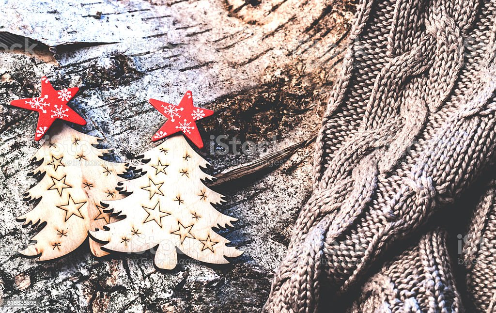 Christmas ornaments are located on a tree bark stock photo