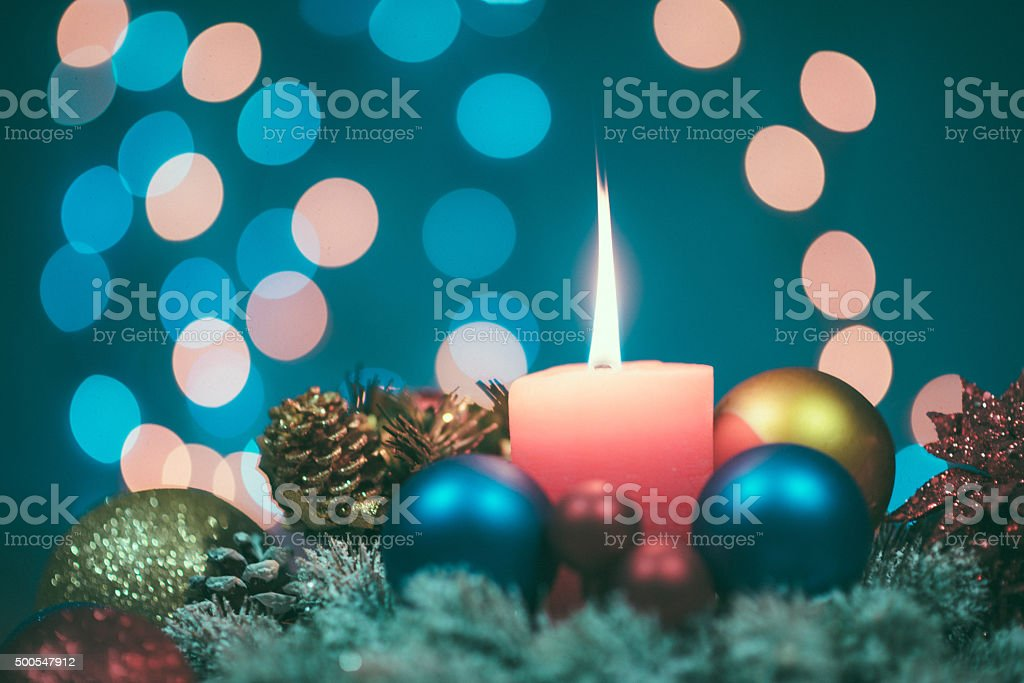 Christmas ornaments, baubles, candle and sparkling lights on Christmas night stock photo