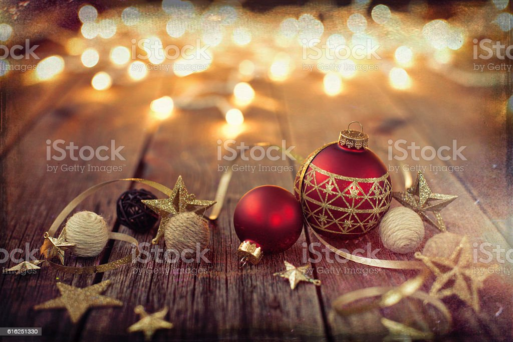 Christmas Ornaments Baubles Ribbon and Lights on Old Wood Background stock photo