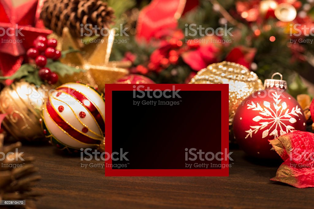 Christmas ornaments, decorations with blank red card. stock photo