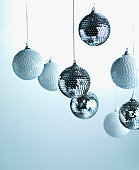 Christmas ornaments hanging from string