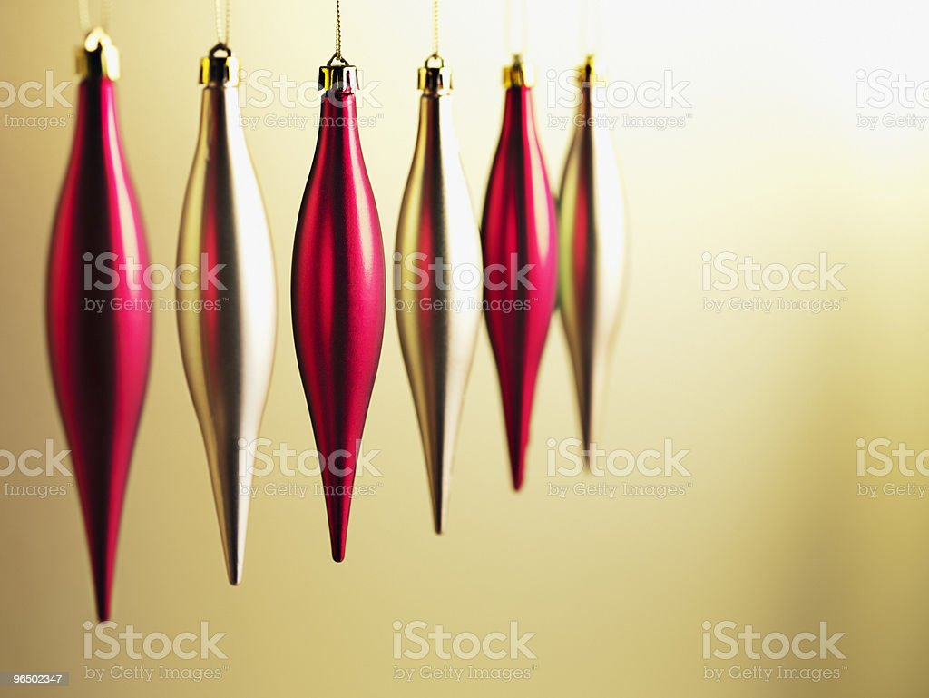 Christmas ornaments hanging in a row royalty-free stock photo