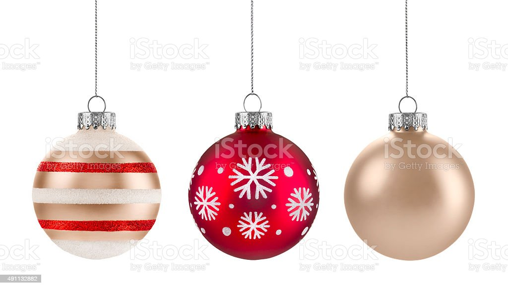 Christmas ornaments in a row isolated on white stock photo