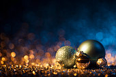 Christmas ornaments on defocused lights. Decorations Bokeh Blue Gold