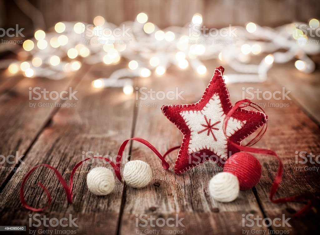 Christmas Ornaments on Old Wood Background with Defocused Lights stock photo