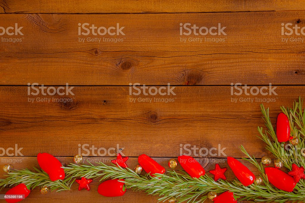 Christmas Ornaments,Chili Peppers and Rosemary sprigs on wood (P) stock photo