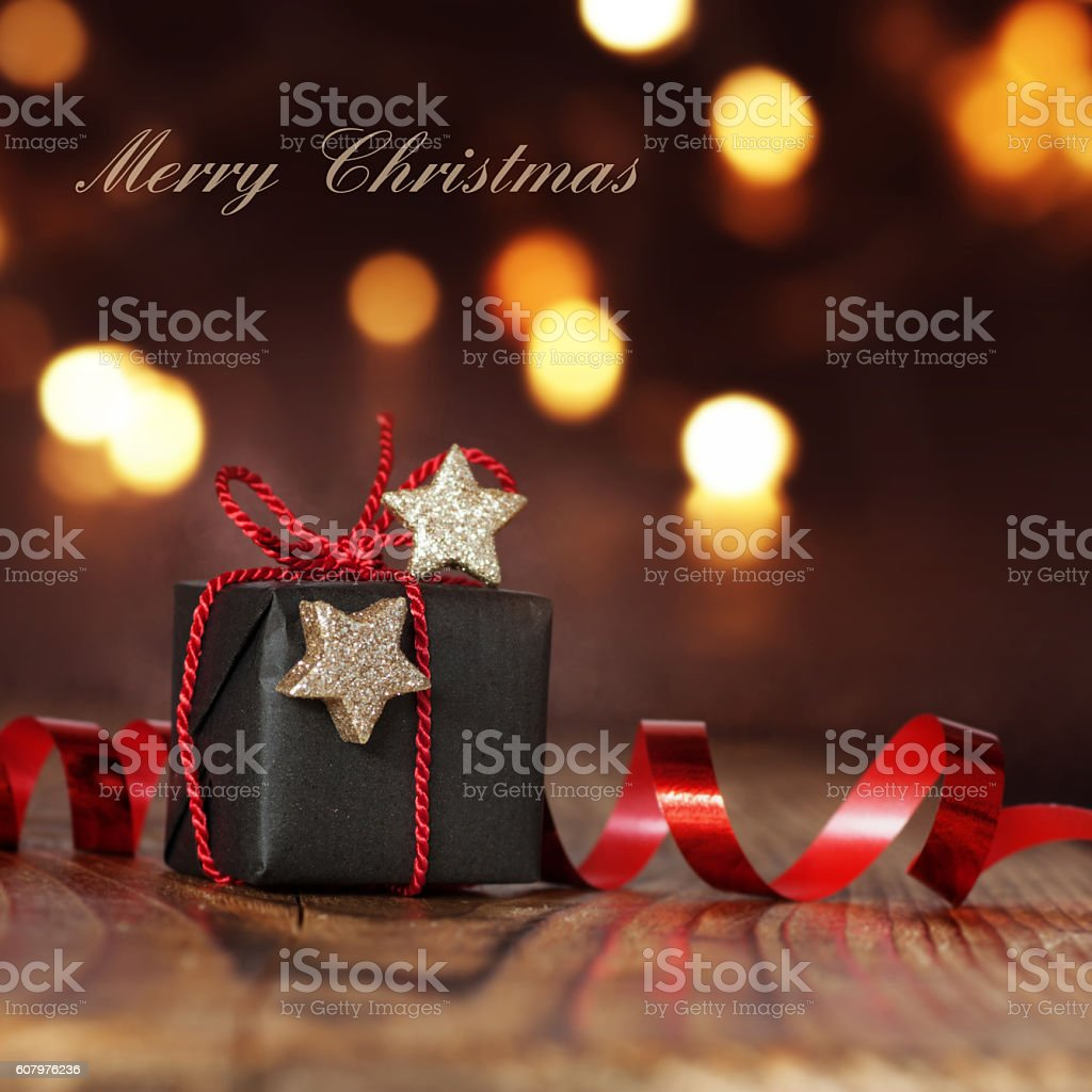 Christmas package with red ribbon stock photo