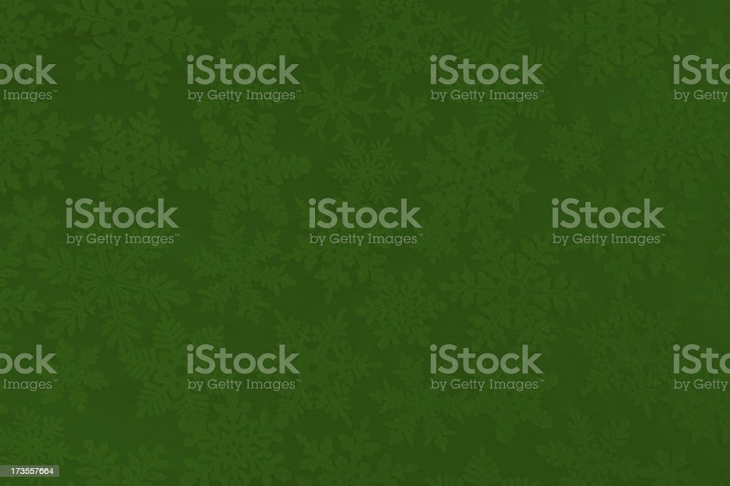 Christmas Paper Texture Background with Green and White Snowflakes stock photo