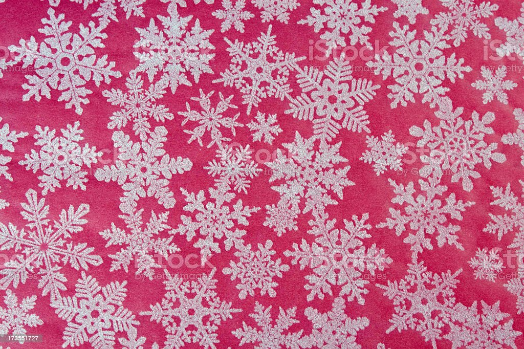Christmas Paper Texture Background with Pink and White Snowflakes royalty-free stock photo