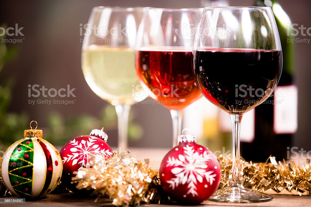 Christmas party with wine in glasses on rustic outdoor table. stock photo