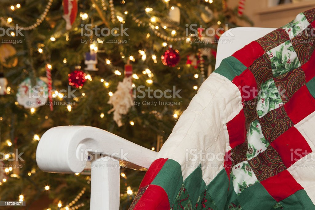 Christmas patchwork quilt in front of tree stock photo