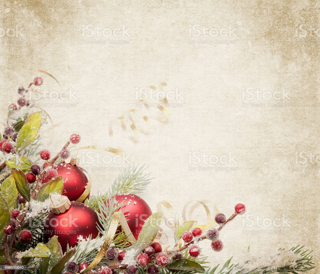 Christmas pine bauble arrangement with ribbon on rustic textured background stock photo