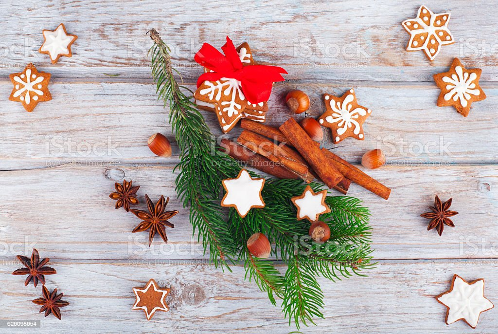 Christmas pine with gingerbread cookies and cinnamon stock photo