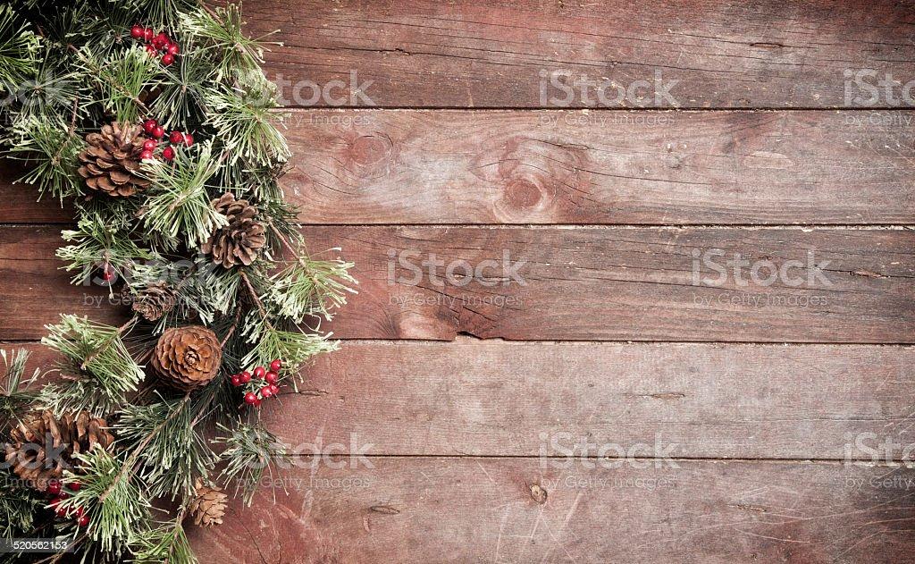 Christmas pine wreath hanging on old wood door stock photo