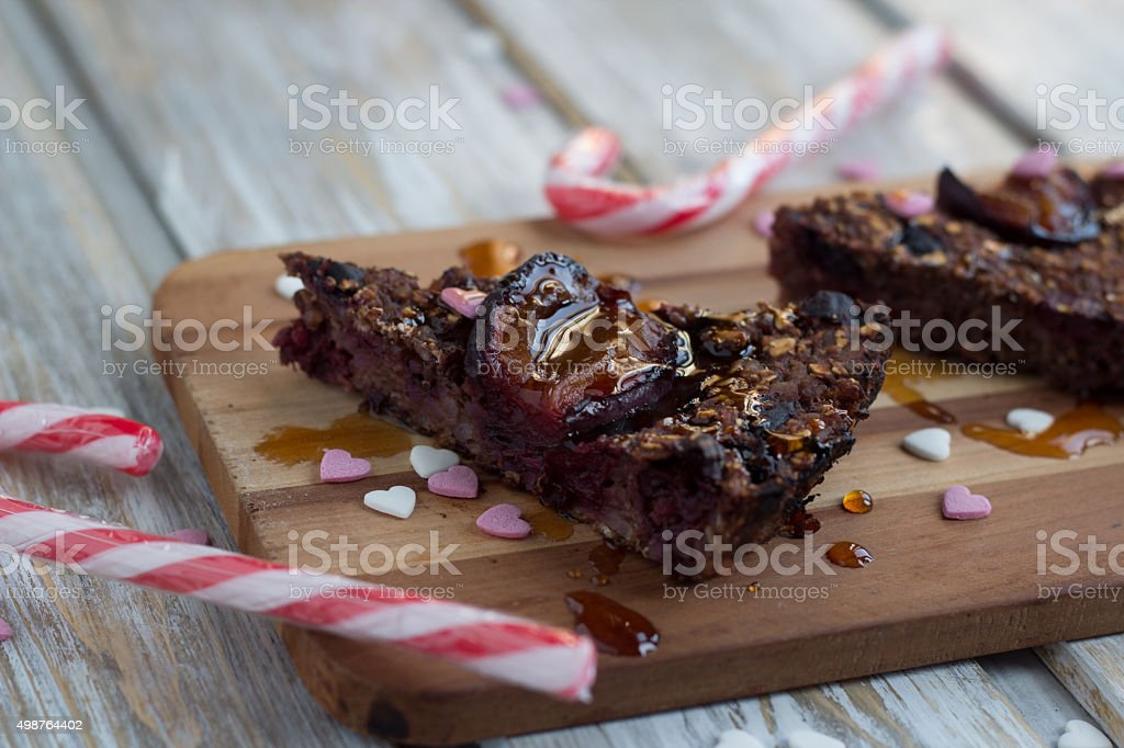 Christmas plum cake with candy canes decoration royalty-free stock photo