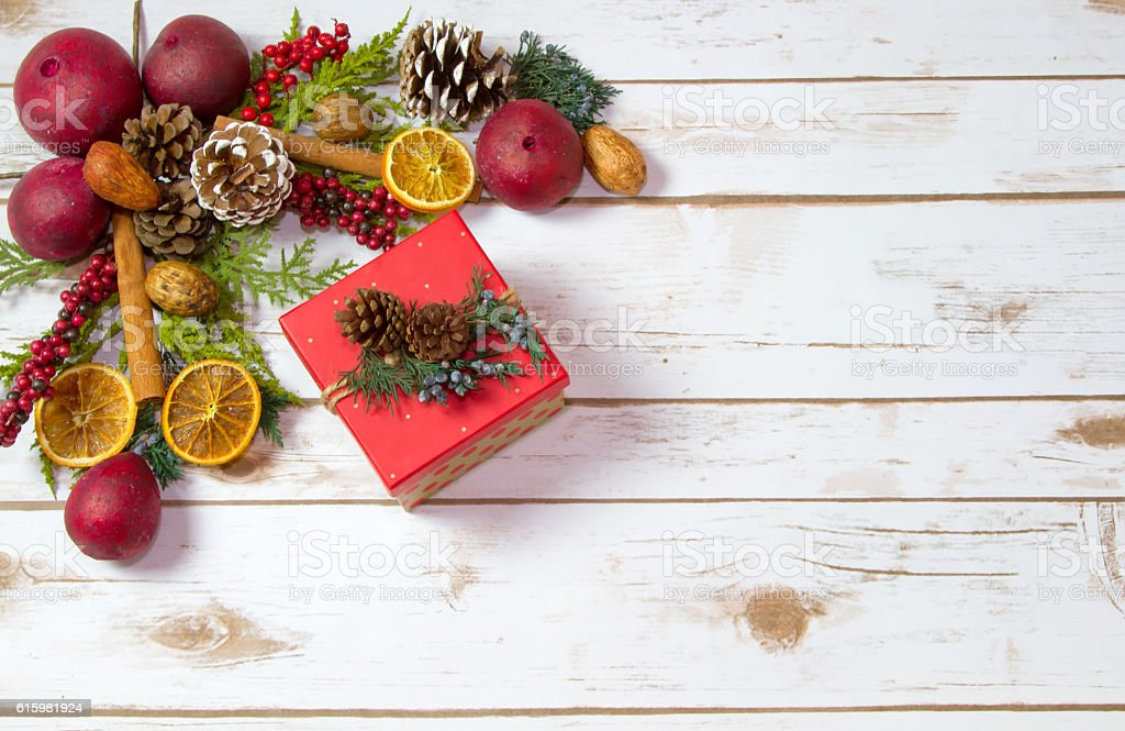 Christmas Potpourri background with a boxed gift stock photo
