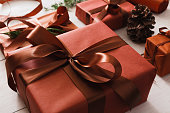 Christmas present boxes on white wood background