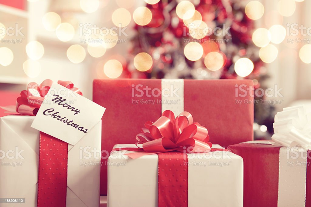 Christmas present  in a room with a Christmas tree stock photo