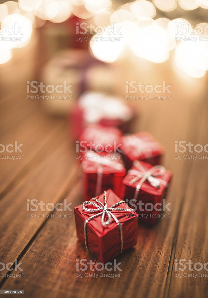 Christmas present on wood background royalty-free stock photo
