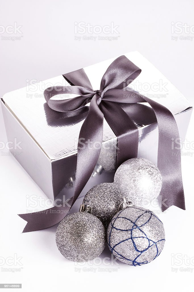Christmas present with ball in silver  tone stock photo
