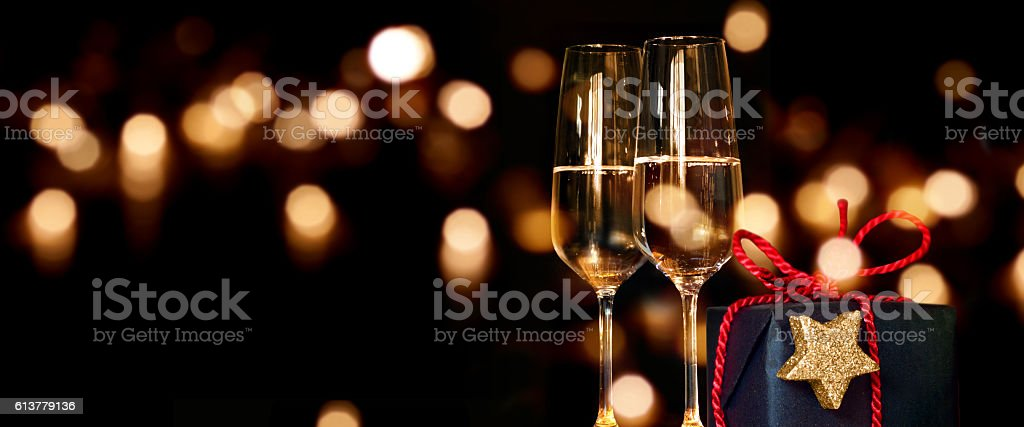 Christmas present with champagne glasses stock photo