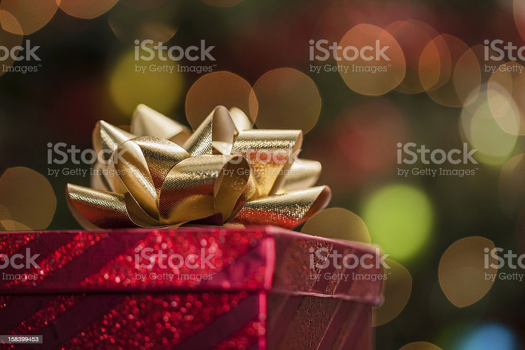 Christmas present with defocusd lights stock photo