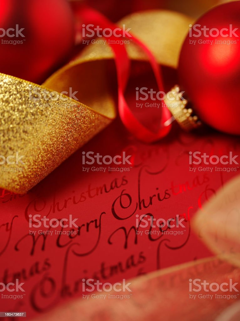 Christmas Present with Ribbon and Baubles royalty-free stock photo