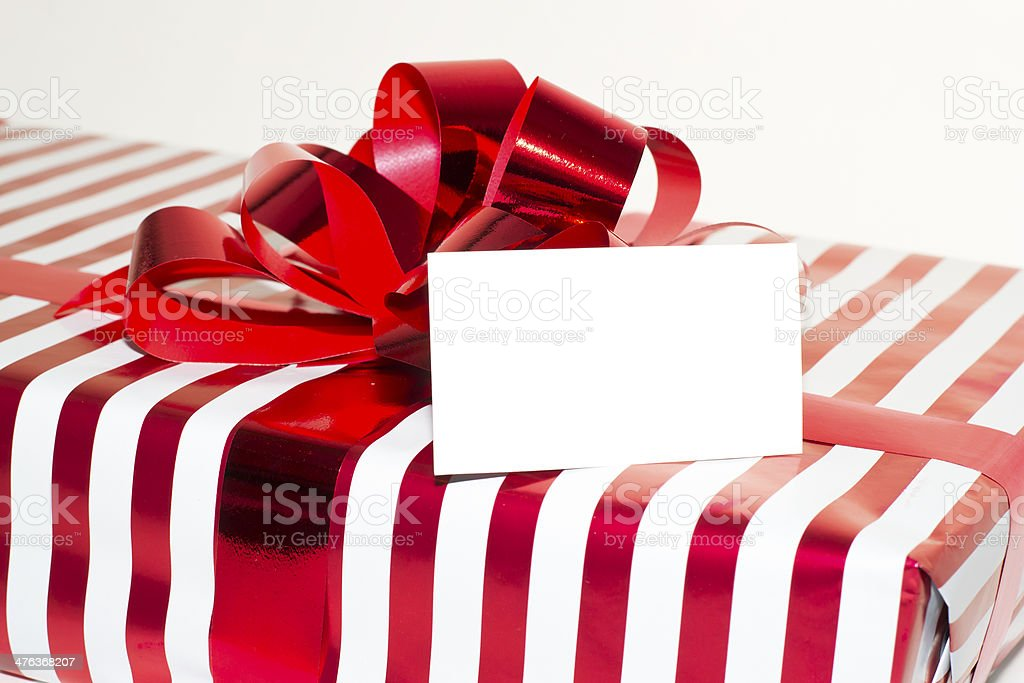 Christmas Present with Ribbon and tag. Isolated on white background. royalty-free stock photo