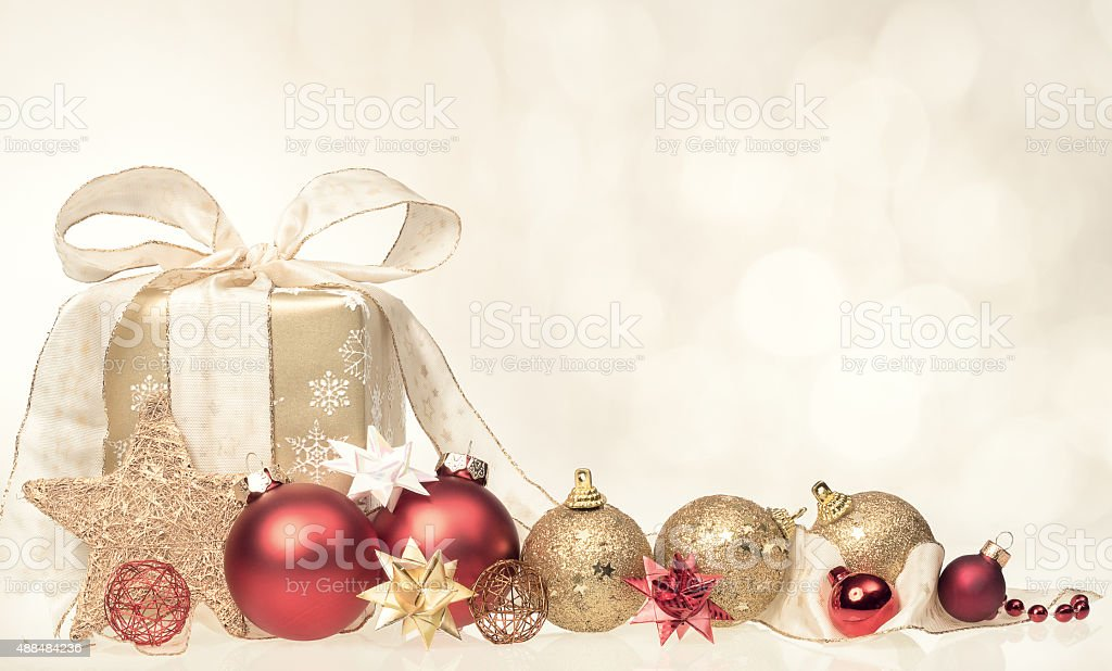 Christmas present with xmas bubbles and ribbon stock photo