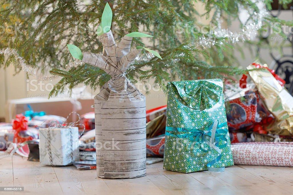 Christmas presents below the Christmas tree stock photo