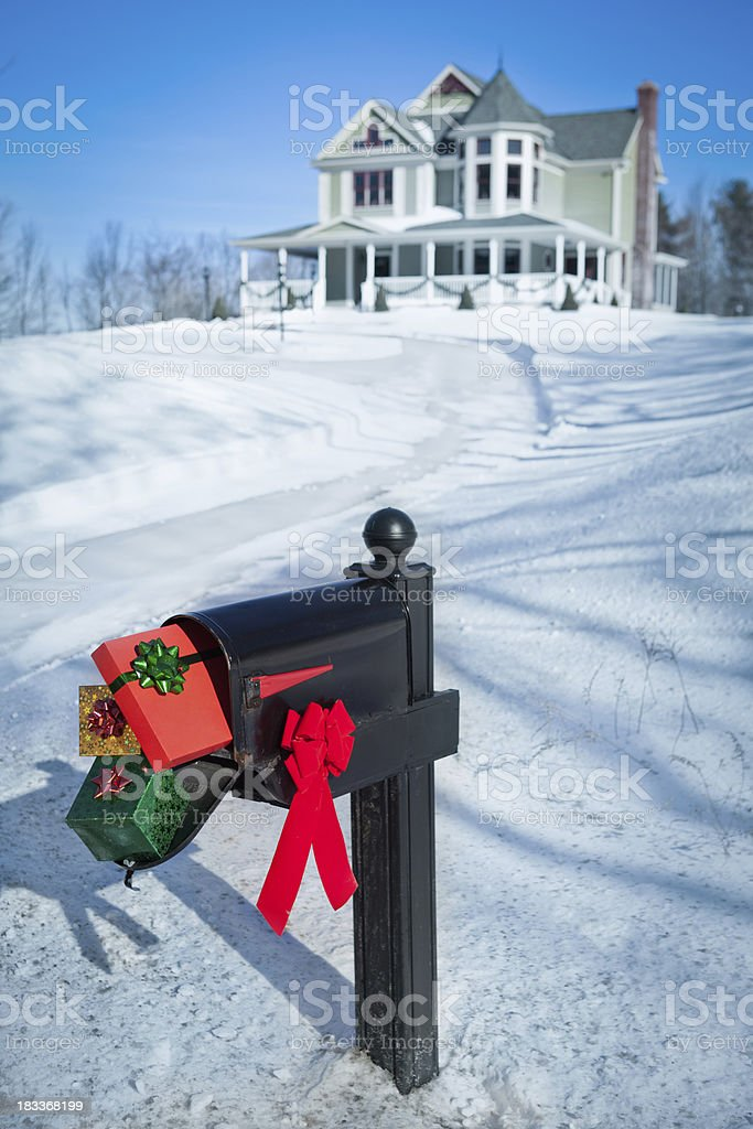Christmas presents in a mailbox stock photo