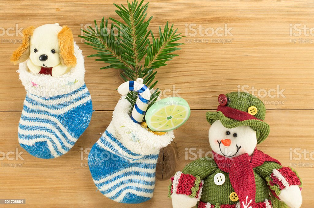 Christmas presents in socks and fir tree stock photo