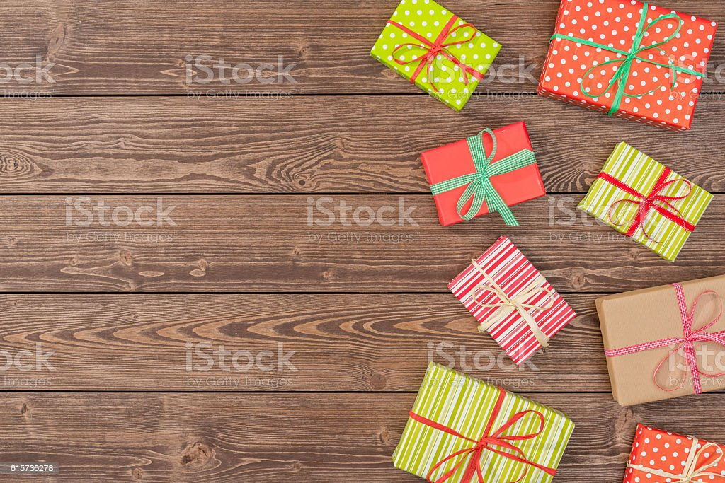 Christmas presents on wooden table stock photo