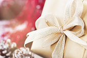 Christmas presents or gifts with elegant bow and christmas decorations
