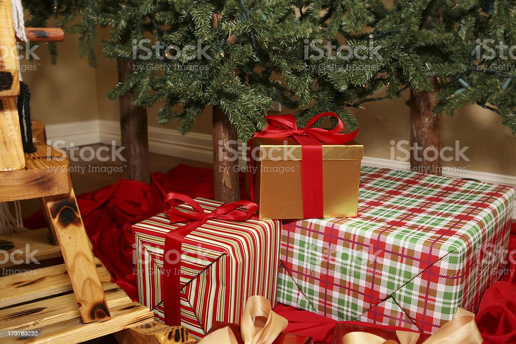 Christmas Presents Sitting Under A Tree stock photo