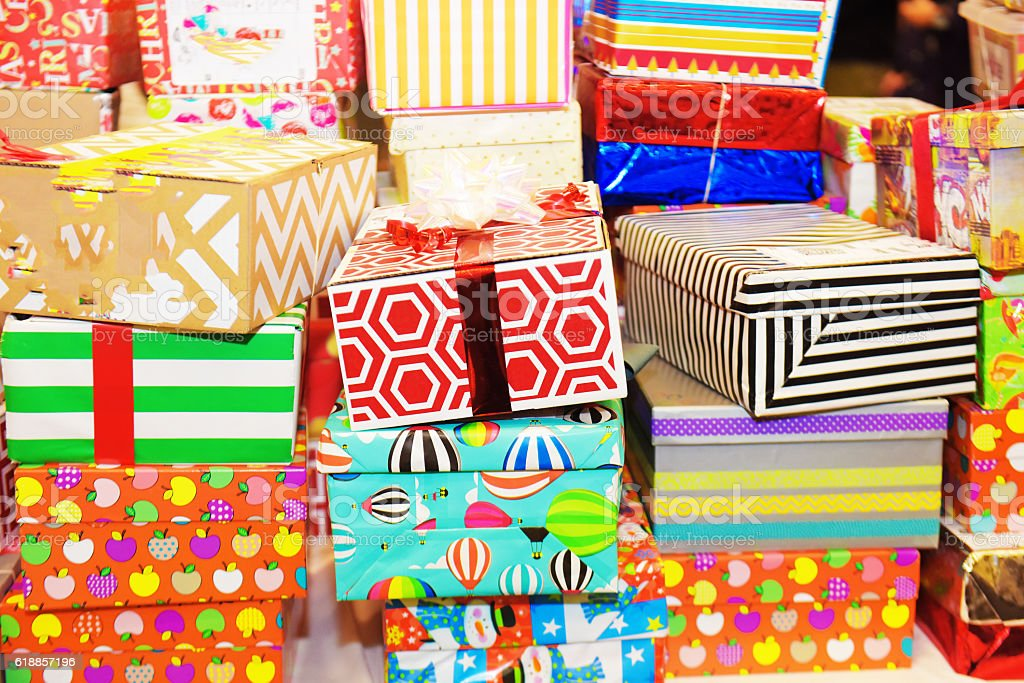Christmas presents stacked in the shop stock photo