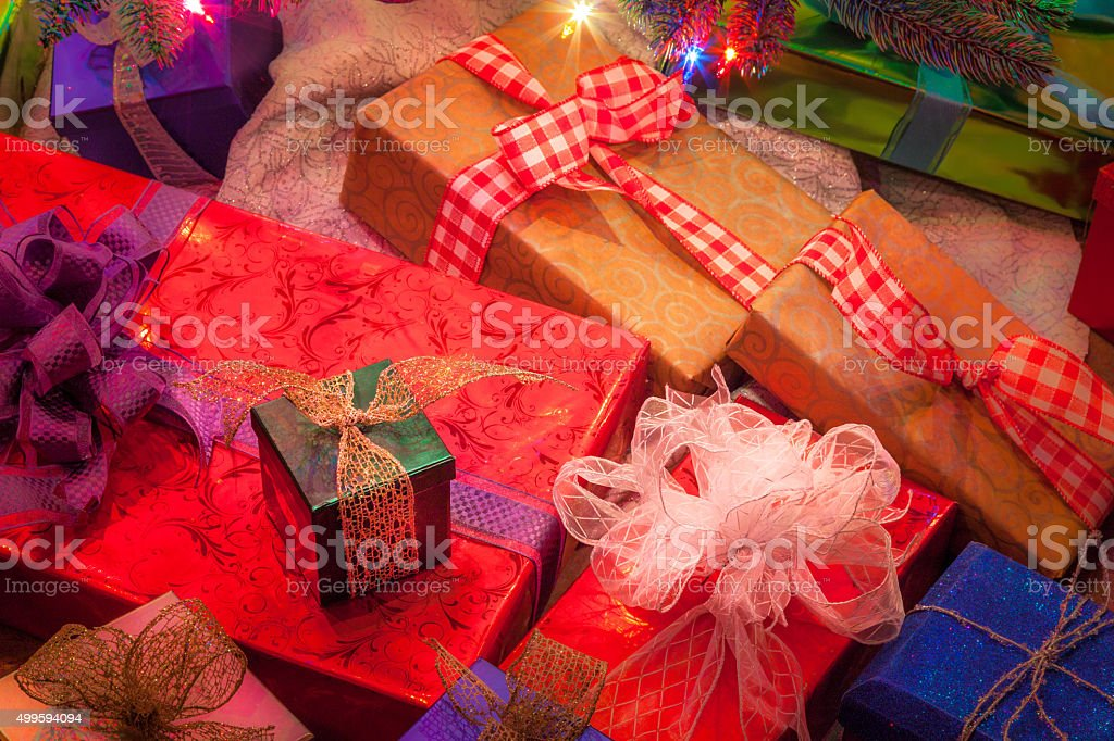 Christmas presents stacked ,with ribbon,bows, under tree(P) stock photo