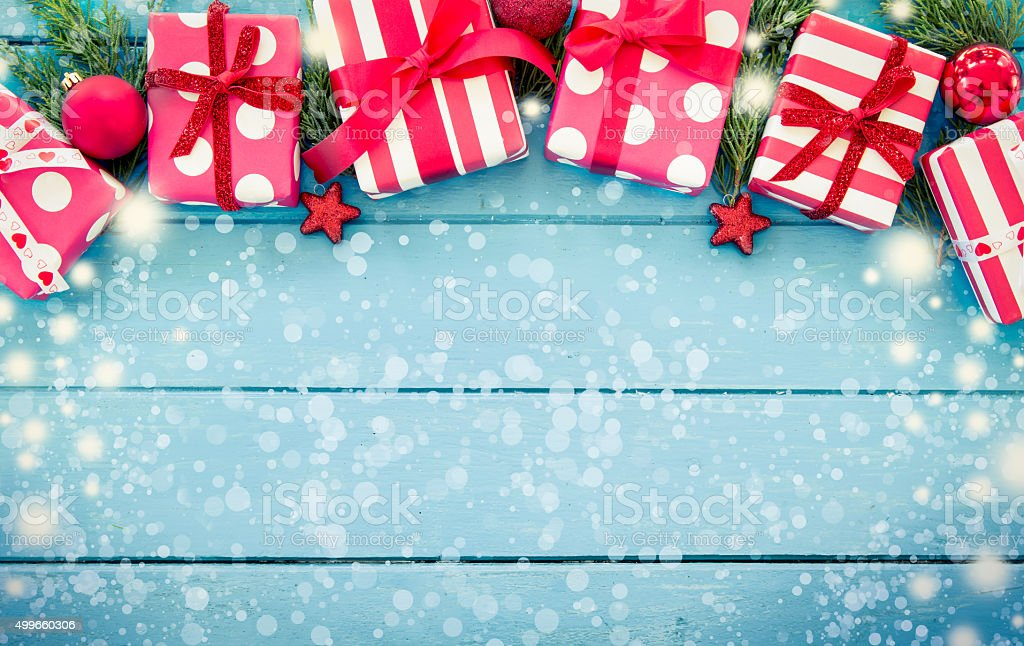 Christmas presents with decoration on blue wooden table stock photo