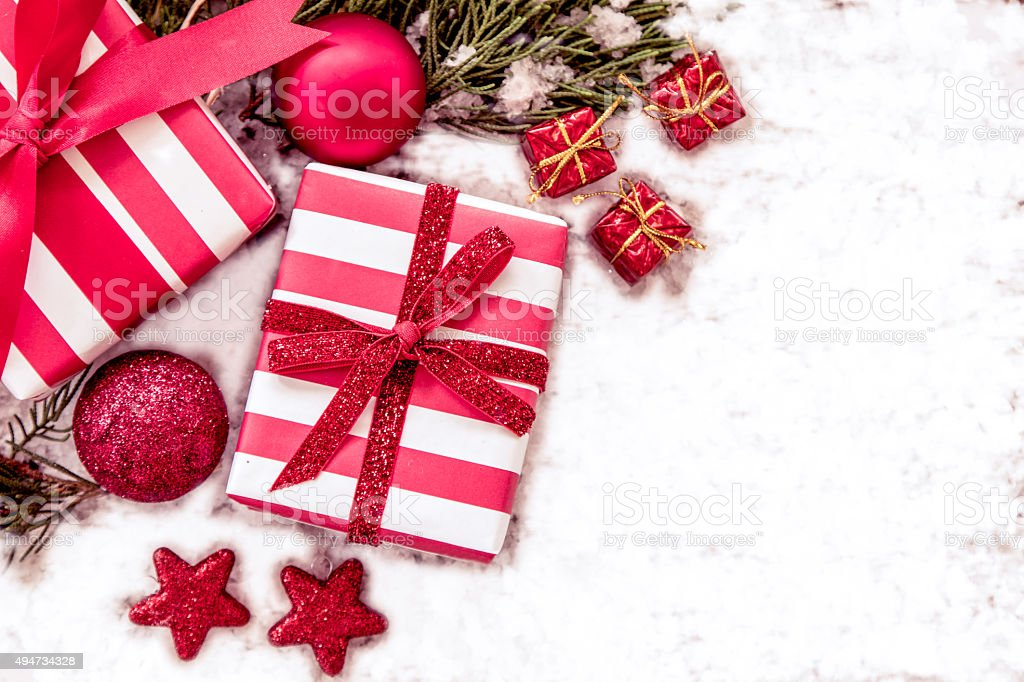 Christmas presents with decoration on snow stock photo