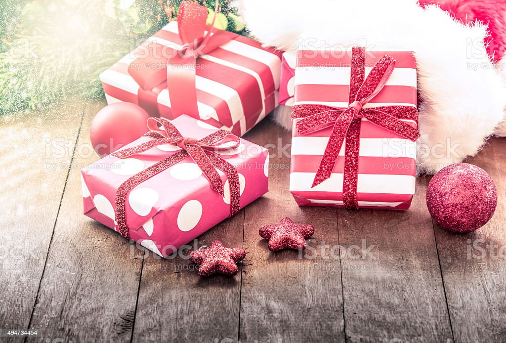 Christmas presents with decoration on wooden table stock photo