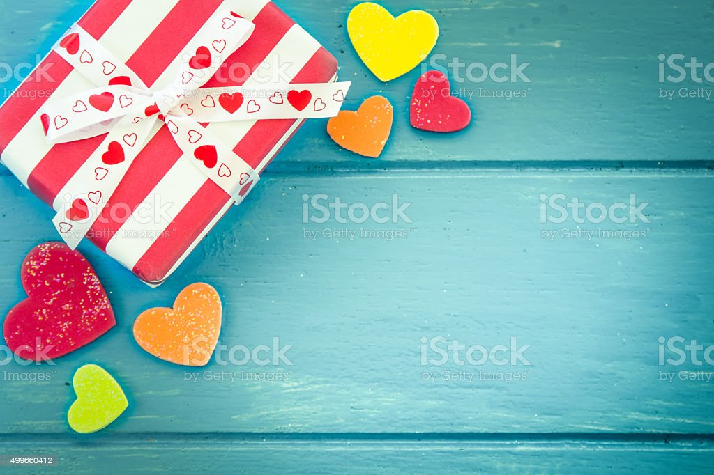 Christmas presents with heart on blue wooden table stock photo