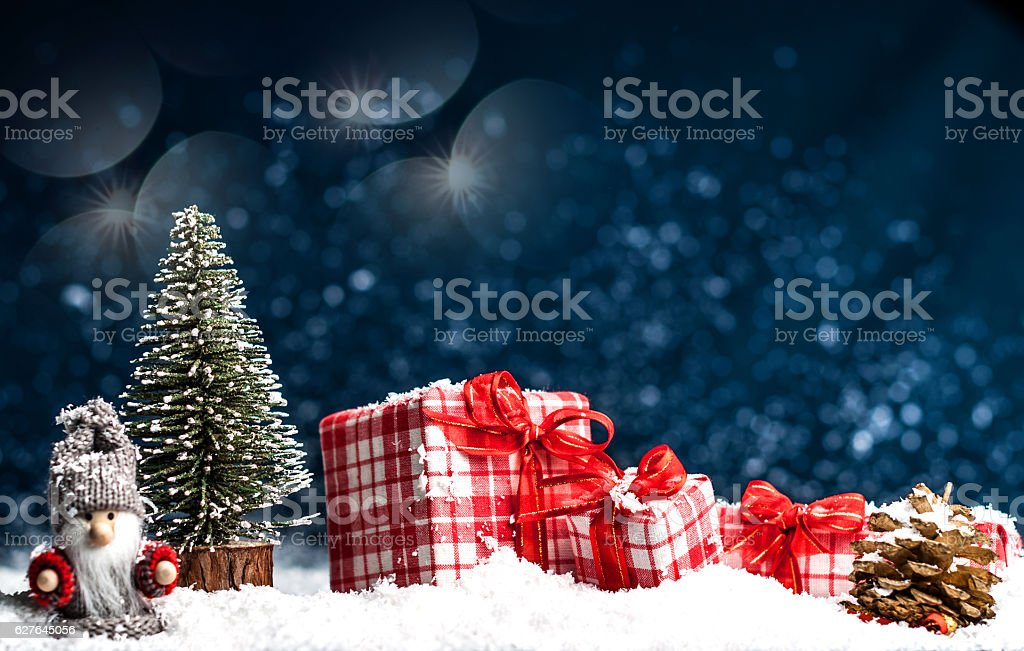 Christmas presents with red bows in the snow stock photo