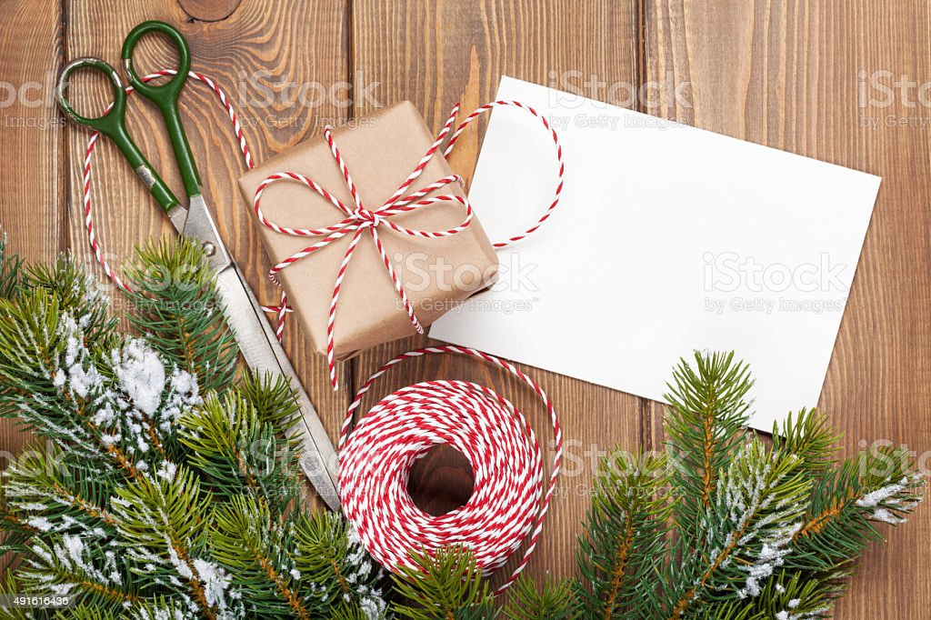 Christmas presents wrapping and snow fir tree stock photo