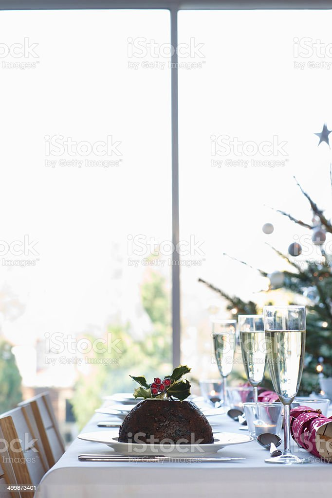 Christmas Pudding On Dining Table stock photo