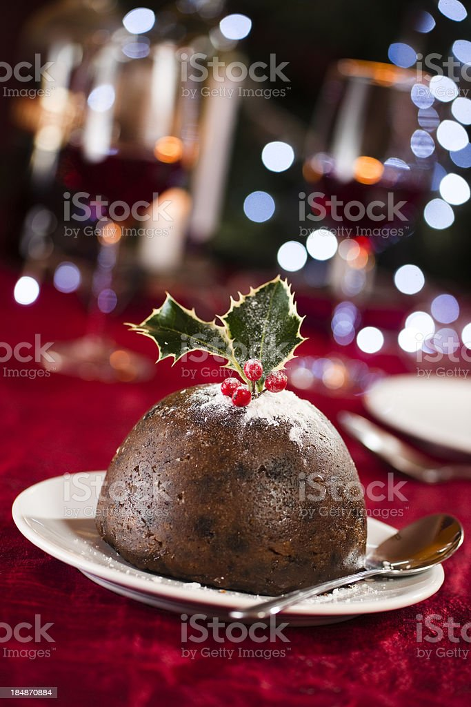Christmas pudding on red cloth royalty-free stock photo