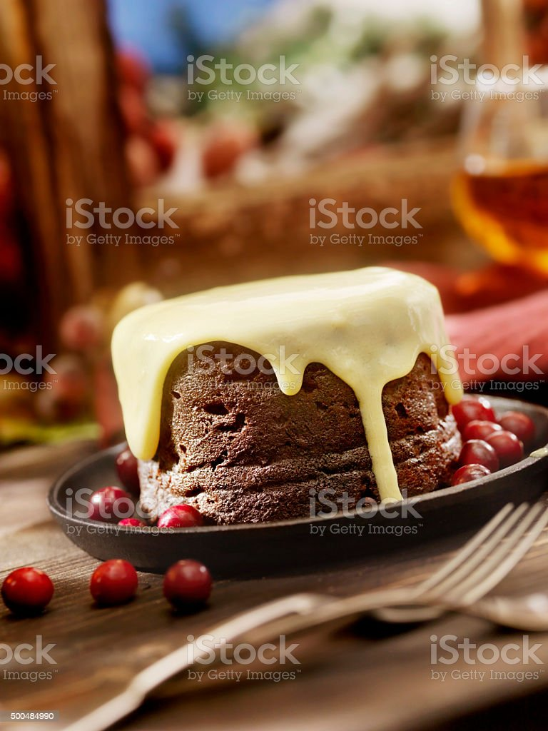 Christmas Pudding with Custard stock photo