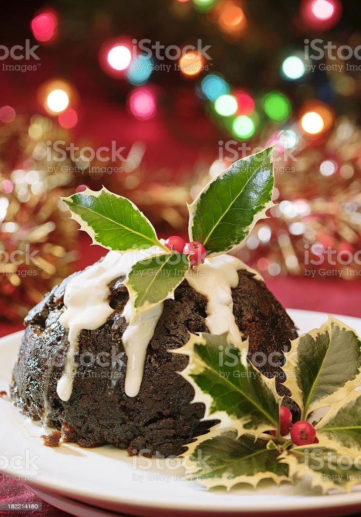 Christmas pudding with holly and lights royalty-free stock photo