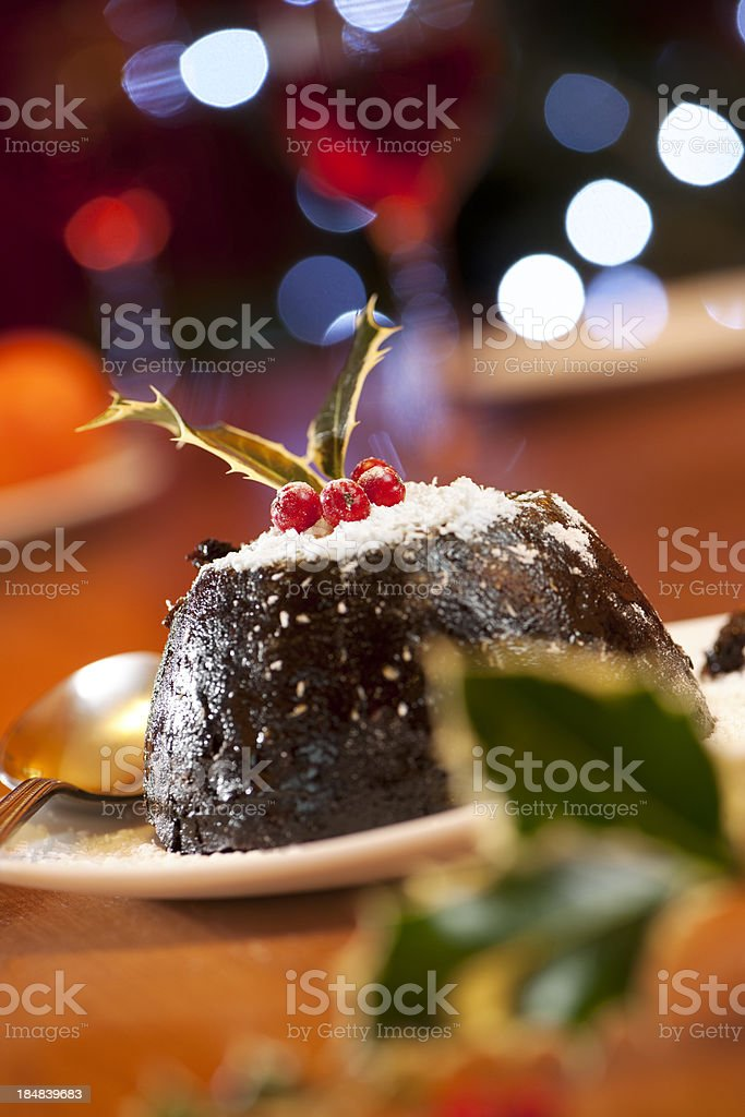 Christmas pudding with holly garnish royalty-free stock photo